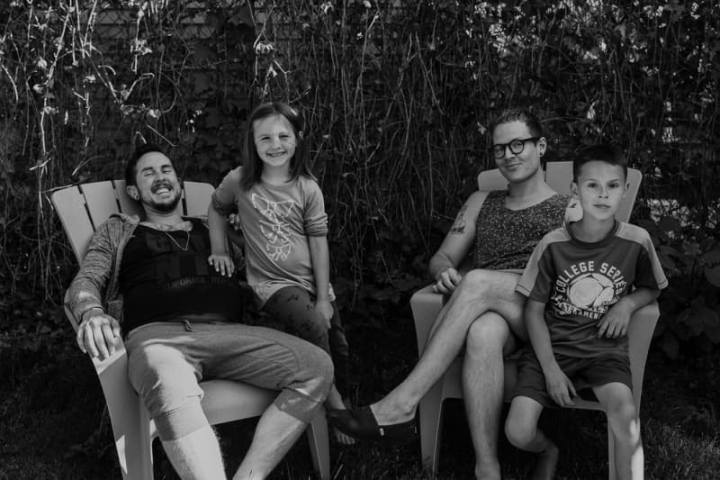 Black and White Photo of Trystan, Biff and their Two Children in their Yard