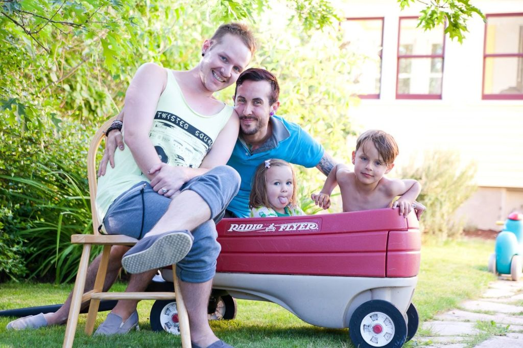 Biff and Trystan with their Two Children in a Wagon